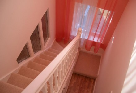 White staircase with carpet from MPK Lofts