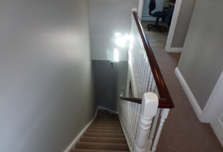 Stairs leading to 1st floor