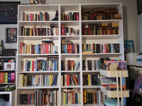 books on bookshelves, book trolley, library