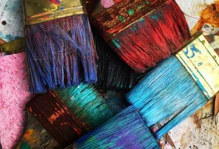paint brushes with bright coloured paint