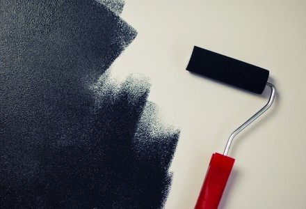 painting-black-paint-roller-wall