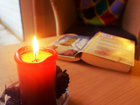 book, candle, half read book, reading